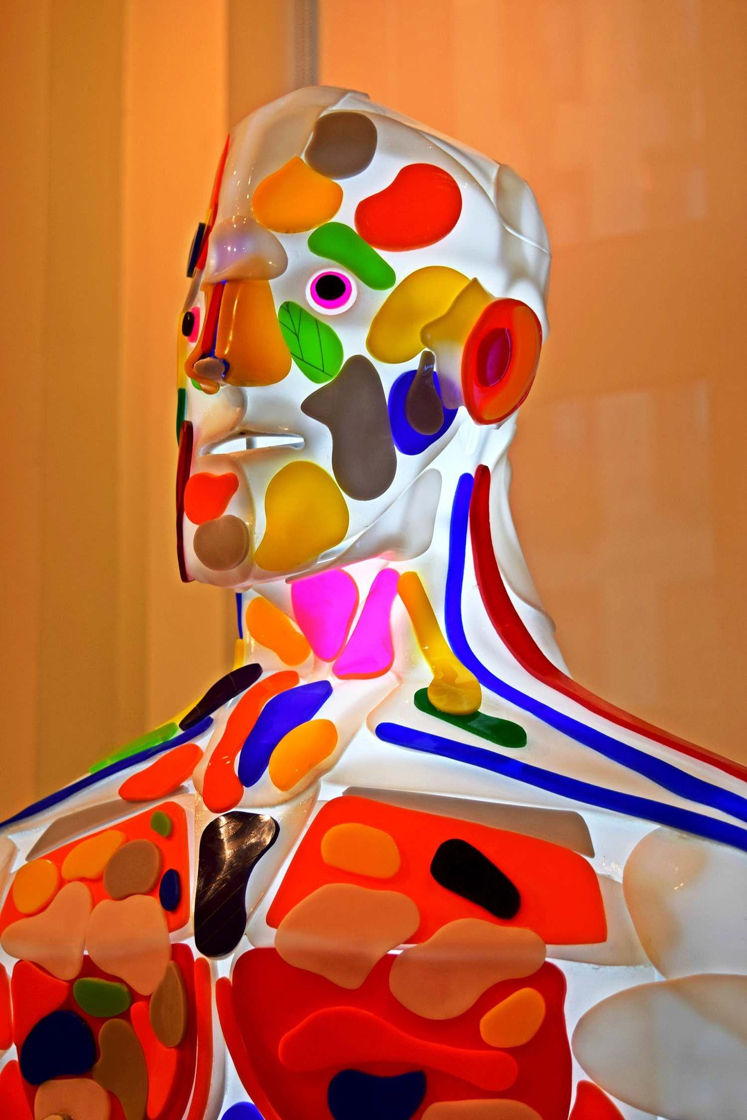 Enlightened man, light sculpture, half profile view