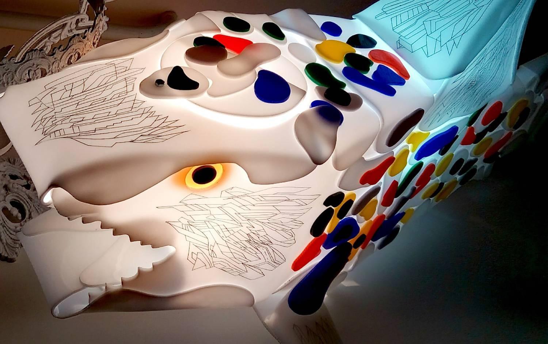 Ocean wave is a shark sculpture made of plexiglass.