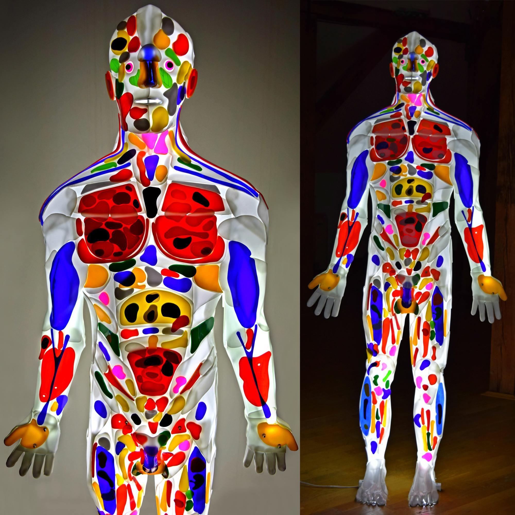 Enlightened man is a light sculpture of man made from Plexiglas.